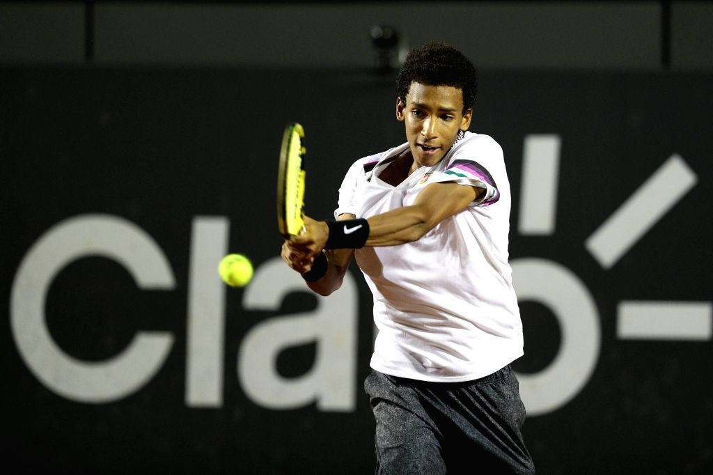 RIO DE JANEIRO, Feb. 24, 2019 - Felix Auger-Aliassime of Canada hits a return during the men's singles semifinal between Felix Auger-Aliassime of Canada and Pablo Cuevas of Uruguay at the Rio open ...