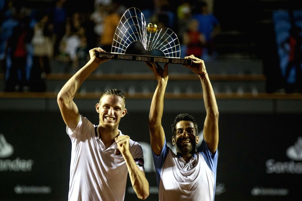 RIO DE JANEIRO, Feb. 24, 2019 - Maximo Gonzalez (R) of Argentina and Nicolas Jarry of Chile hold up the trophy during the awarding ceremony after the men's doubles final against Thomaz Bellucci and ...