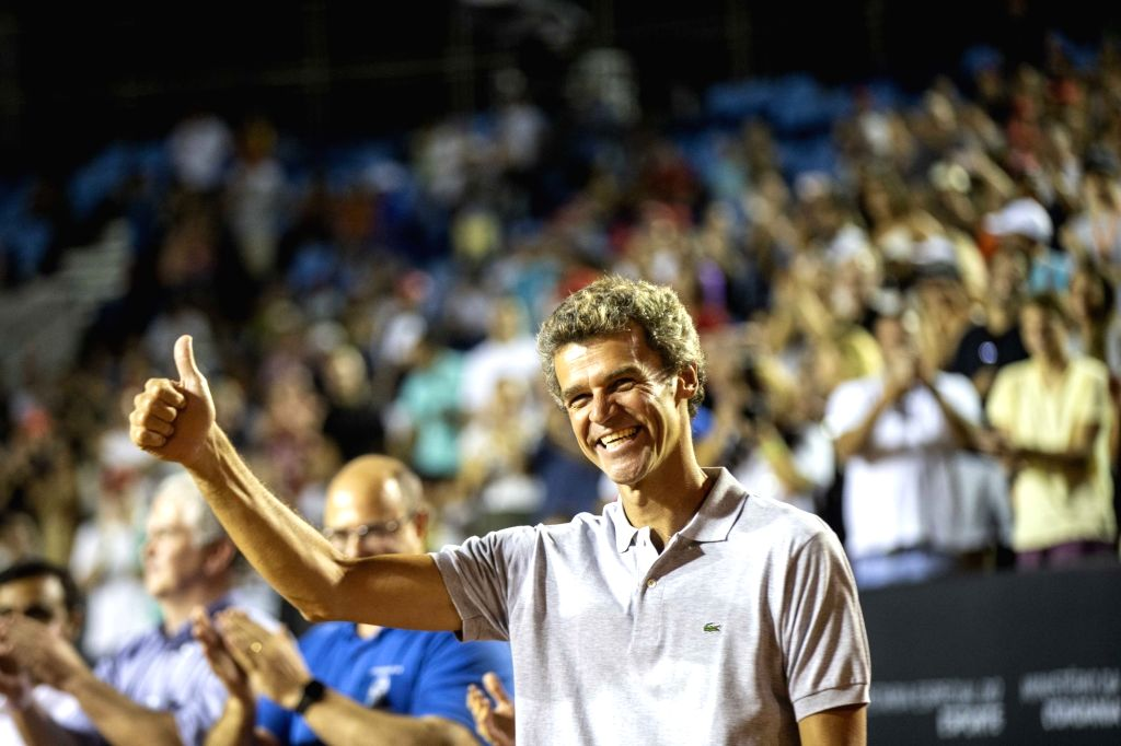 RIO DE JANEIRO, Feb. 25, 2019 - Brazilian former tennis player Gustavo Kuerten greets the audience during the awarding ceremony after the men's singles final against Felix Auger-Aliassime of Canada ...