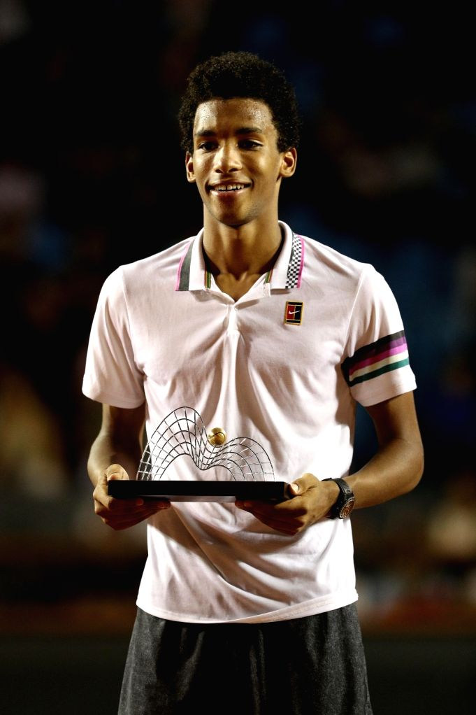 RIO DE JANEIRO, Feb. 25, 2019 - Felix Auger-Aliassime of Canada poses for photo during the awarding ceremony after the men's singles final against Laslo Djere of Serbia at the Rio open 2019 ...