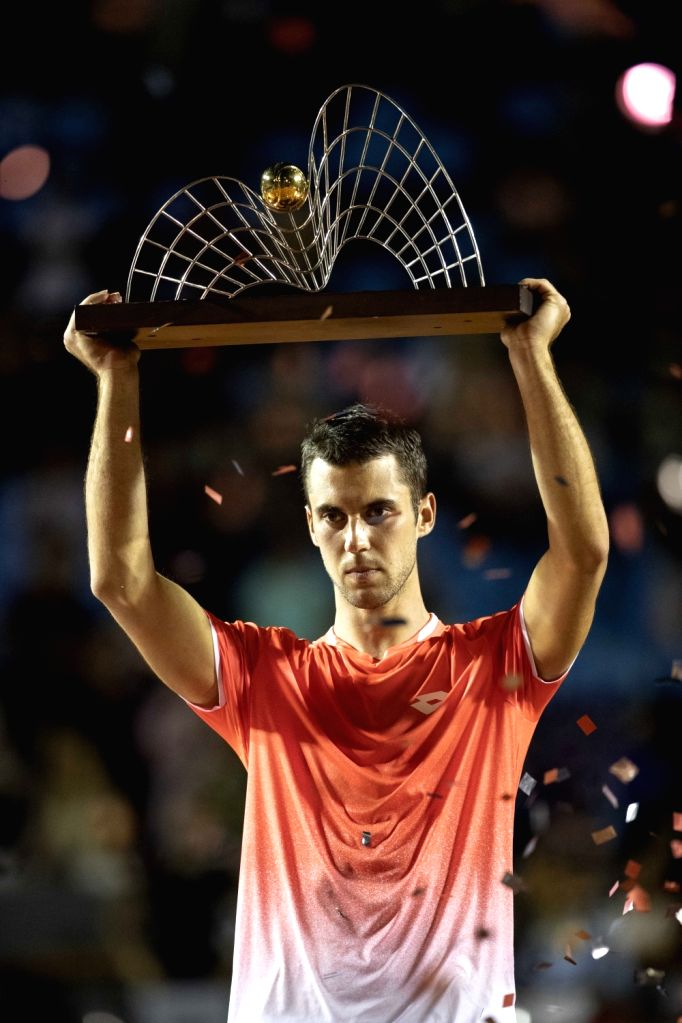 RIO DE JANEIRO, Feb. 25, 2019 - Laslo Djere of Serbia holds up the trophy during the awarding ceremony after the men's singles final against Felix Auger-Aliassime of Canada at the Rio open 2019 ...