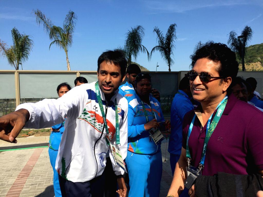 Rio De Janeiro: Former Indian cricketer Sachin Tendulkar with the Indian badminton coach P Gopichand at the Games Village in Rio de Janeiro on Aug. 6, 2016. - Sachin Tendulkar