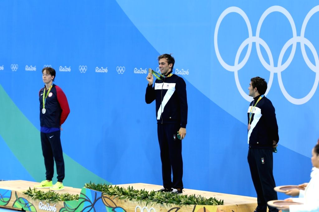 Rio De Janeiro: Gregorio Paltrinieri (Italy) Connor Jaeger (US) and Gabriele Detti (Italy) who won gold, silver and bronze in Men's 1500m Freestyle at Rio 2016 Olympics during the presentation ...