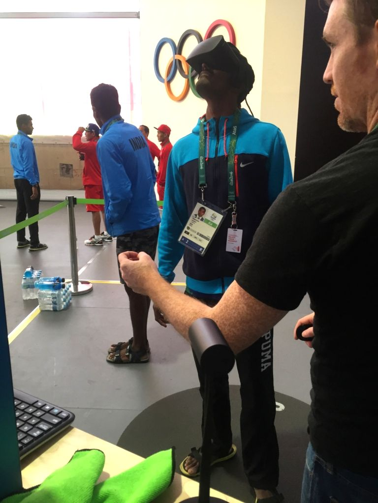 Rio De Janeiro: Indian 4X400m relay team member Arokia Rajiv trys a Virtual Reality Glasses at the Olympic Village in Rio De Janeiro on July 29, 2016.