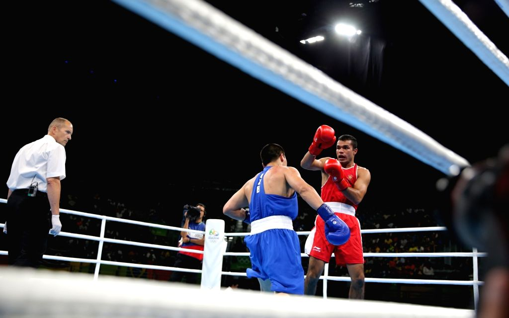 Rio de Janeiro: Indian boxer Vikas Krishan Yadav competes with Bektemir Melikuziev of Uzbekistan in the quarter-finals of the men`s Middleweight (75kg) category at the Rio Olympics in Rio de Janeiro ... - Vikas Krishan Yadav
