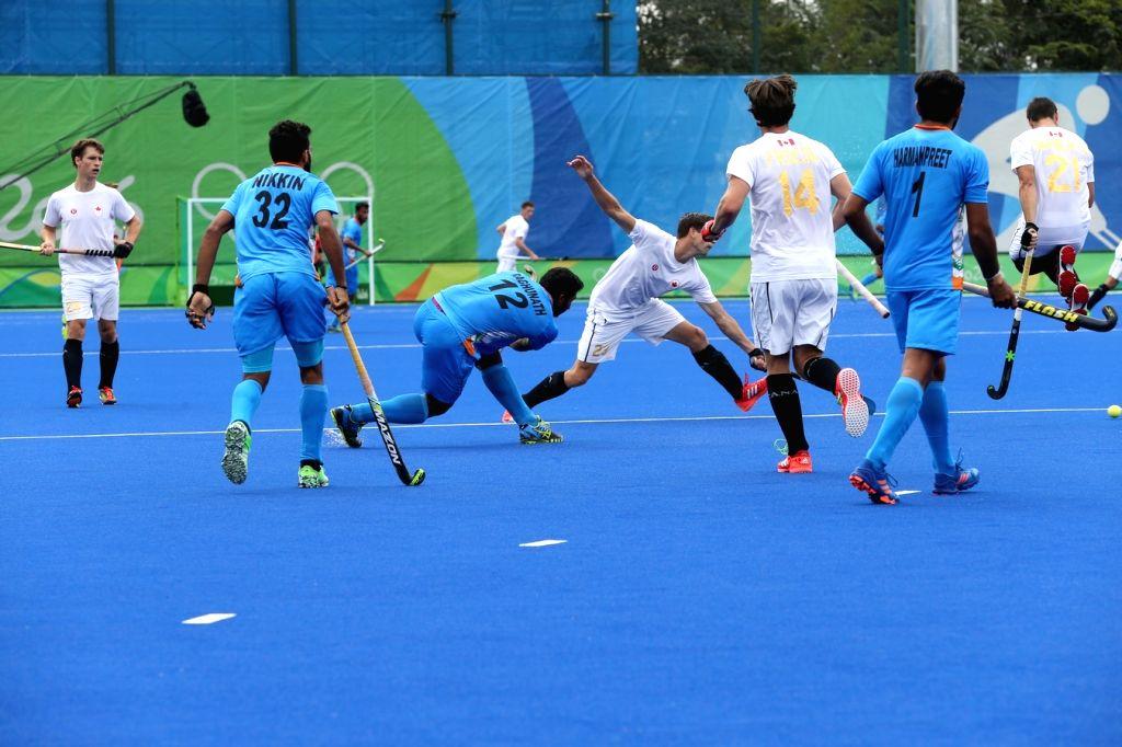 Rio de Janeiro: Indian men's hockey team in action against Canada in Rio de Janeiro on Aug. 12, 2016.
