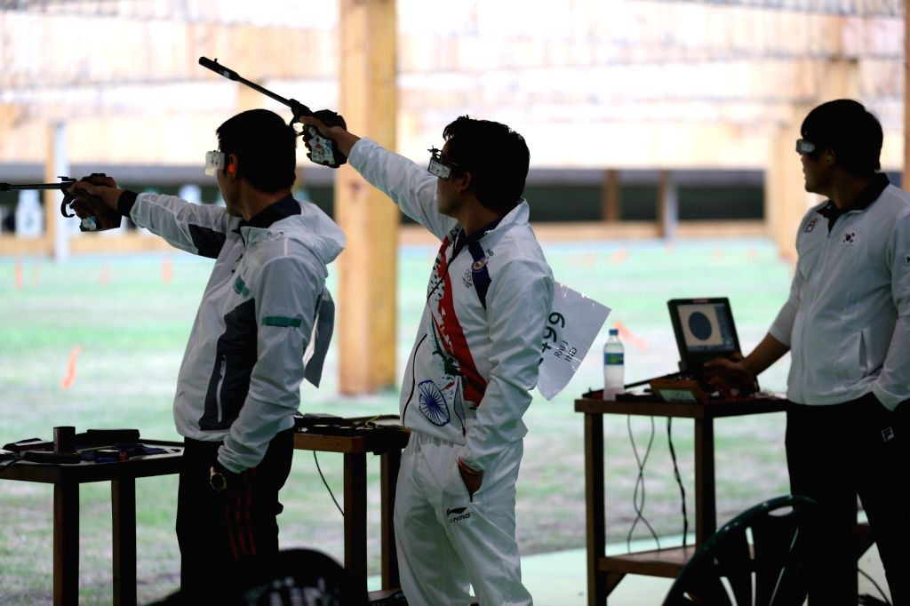 Rio de Janeiro: Indian shooter Jitu Rai and Prakash Nanjappa  in action in 50 metre Pistol Men's event at the Olympic Shooting centre in Rio de Janeiro, on Aug. 11, 2016. - Jitu Rai