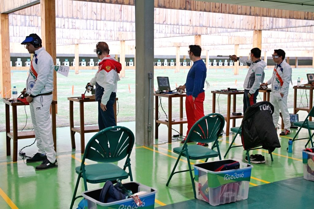 Rio de Janeiro: Indian shooter Jitu Rai (extreme right) and Prakash Nanjappa  (extreme left) in action in 50 metre Pistol Men's event at the Olympic Shooting centre in Rio de Janeiro, on Aug. 11, ... - Jitu Rai