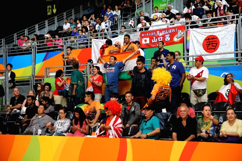 Rio de Janeiro: Indian spectators cheer as shuttler P.V. Sindhu compete against Tai Tzu-ying of Chinese Taipei at Rio Olympics in Rio de Janeiro on Aug. 15, 2016. P.V. Sindhu entered the ...