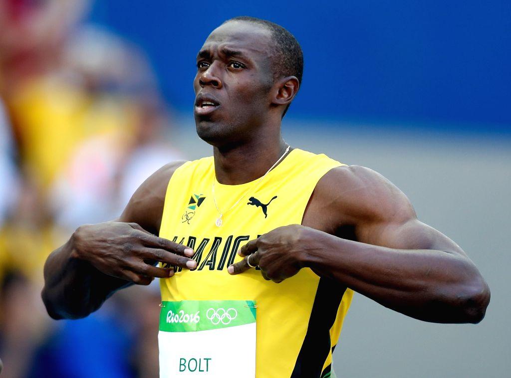 Rio de Janeiro: Jamaican speedster Usain Bolt in action during Mens 100m heats at the Rio 2016 Olympics in Rio de Janeiro on Aug 13, 2016.