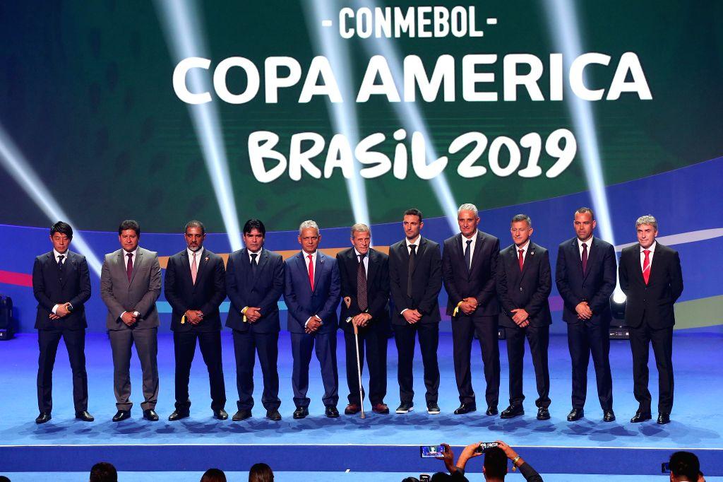 RIO DE JANEIRO, Jan. 25, 2019 - Representatives of the teams pose for group photos after the official draw ceremony of the CONMEBOL Copa America 2019 in Rio de Janeiro, Brazil, on Jan. 24, 2019. The ...