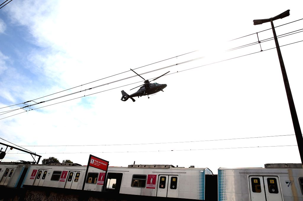 RIO DE JANEIRO, July 17, 2016 - A helicopter flies over the Deodoro Station during a drill on external attack as preparations for the Rio 2016 Games, in Rio de Janeiro, Brazil, on July 16, 2016.