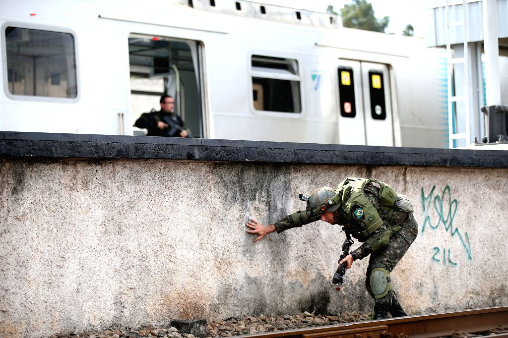 RIO DE JANEIRO, July 17, 2016 - A soldier moves towards the train at the Deodoro Station during a drill on external attack as preparations for the Rio 2016 Games, in Rio de Janeiro, Brazil, on July ...