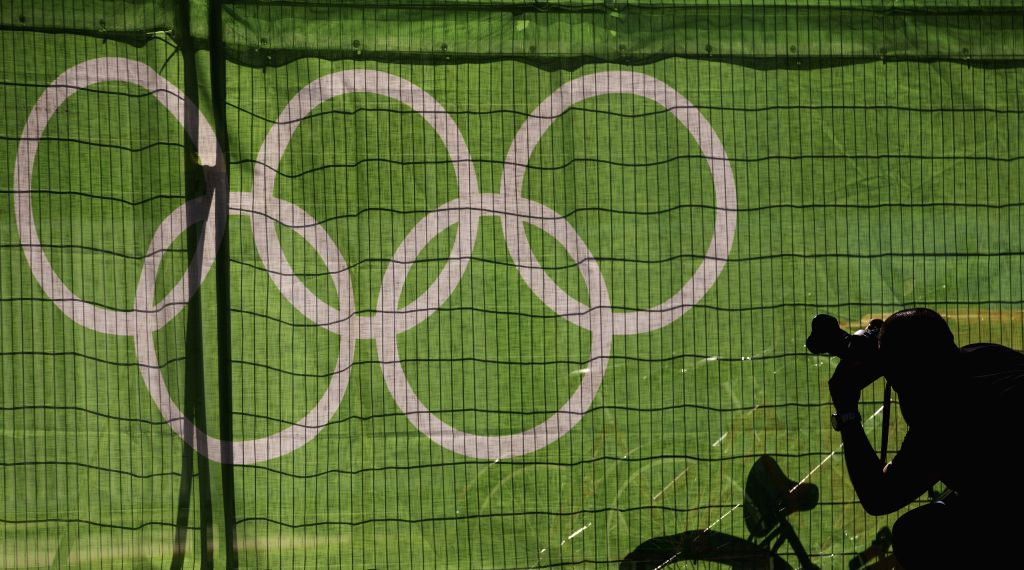 RIO DE JANEIRO, July 25, 2016 - A photographer takes photos in the Olympic Village of the Rio 2016 Olympic Games in Rio de Janeiro, Brazil, July 24, 2016. The opening ceremony of the Olympic Village ...