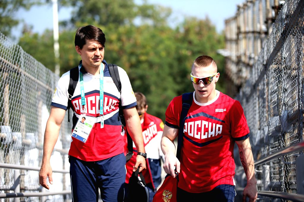 RIO DE JANEIRO, July 27, 2016 - Artistic gymnastics athlete Danis Abliazin (R) of Russia walks to the Olympic village after a training session for the Rio 2016 Olympic Games at the Rio Athlete's Park ...