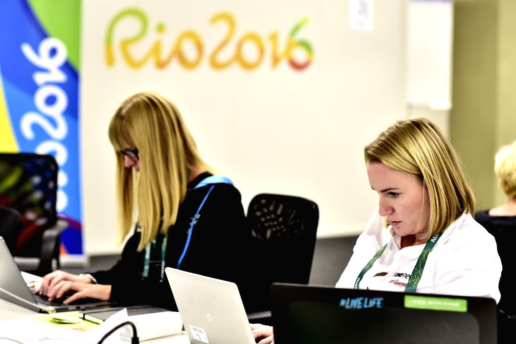 RIO DE JANEIRO, July 30, 2016 - Journalist Abby Wilson (R) from New Zealand works at Main Press Center (MPC) of Rio Olympic Games in Rio de Janeiro, Brazil, on July 30, 2016. More and more ...