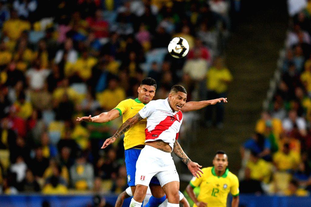 RIO DE JANEIRO, July 8, 2019 (Xinhua) -- Brazil's Casemiro (L) competes with Paolo Guerrero of Peru during the Copa America 2019 final match between Brazil and Peru, held in Rio de Janeiro, Brazil, July 7, 2019. Brazil won 3-1. (Xinhua/Xin Yuewei/IAN