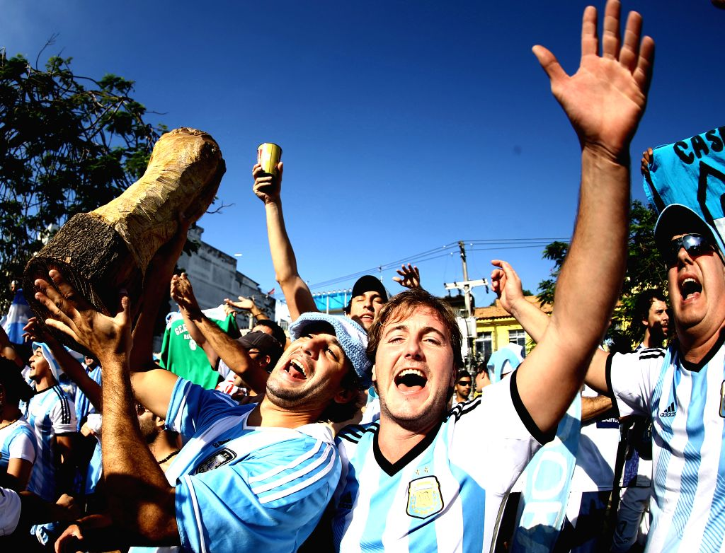 Argentina's fans cheer for their team before a Group F match between Argentina and Bosnia and Herzegovina of 2014 FIFA World Cup in front of the Estadio de ..