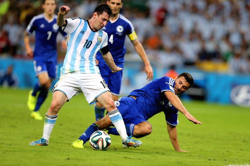 Argentina's Lionel Messi vies for the ball during a Group F match between Argentina and Bosnia and Herzegovina of 2014 FIFA World Cup at the Estadio de ...