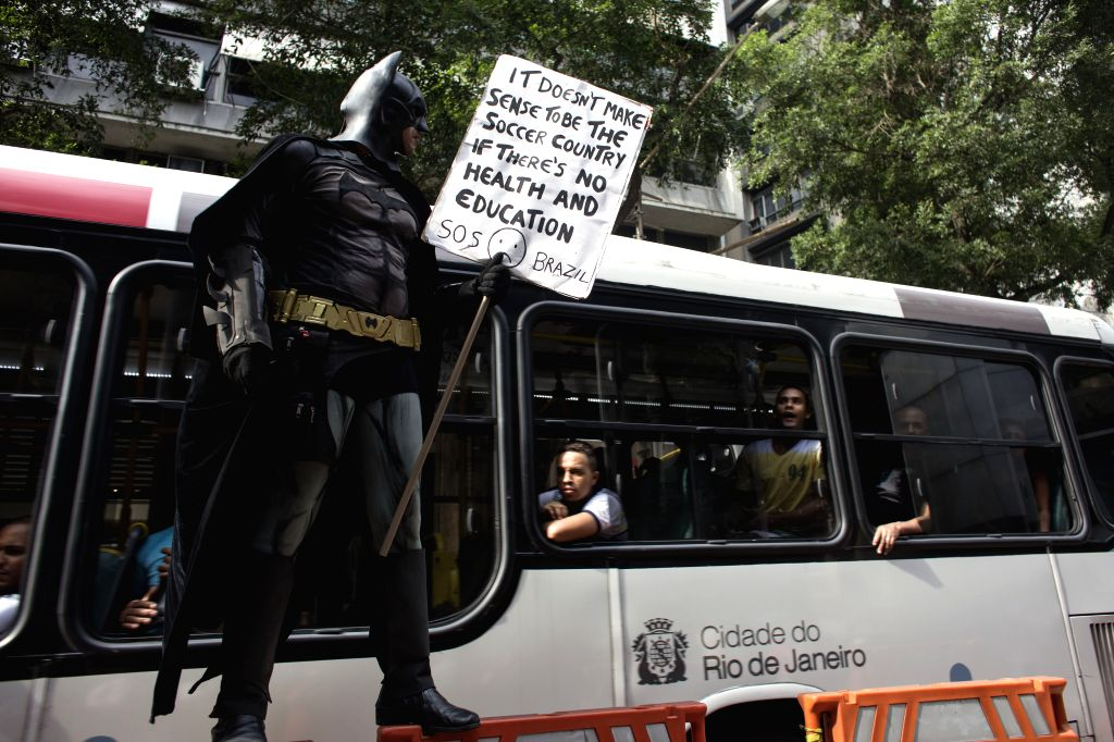 A demonstrator dressed up as Batman attends a protest against the ongoing FIFA World Cup in Rio de Janeiro, Brazil, on June 18, 2014.  Photo: ...