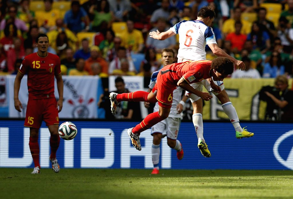 Belgium's Axel Witsel competes with Russia's Maxim Kanunnikov during a Group H match between Belgium and Russia of 2014 FIFA World Cup at the Estadio do ...