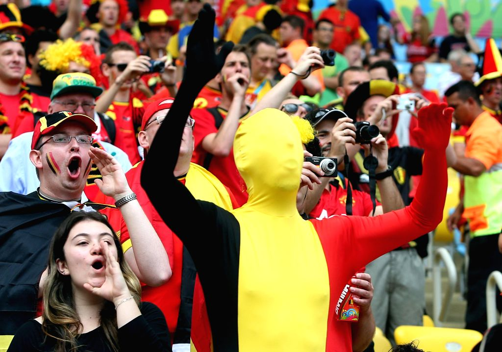 Belgium's fans pose before a Group H match between Belgium and Russia of 2014 FIFA World Cup at the Estadio do Maracana Stadium in Rio de Janeiro, Brazil, June .
