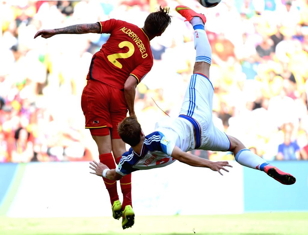 Russia's Aleksandr Kokorin (R) attempts an overhead shot during a Group H match between Belgium and Russia of 2014 FIFA World Cup at the Estadio do Maracana ...