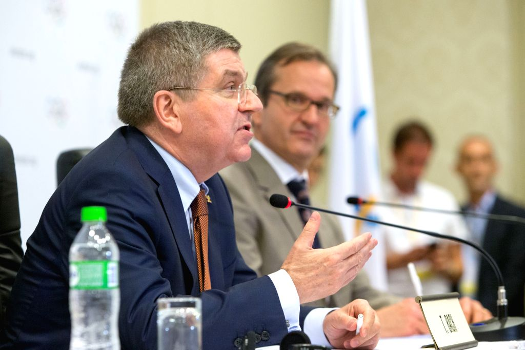 President of the International Olympic Committee (IOC) Thomas Bach (front) attends a press conference in Rio de Janeiro, Brazil, Feb. 28, 2015. A press ...