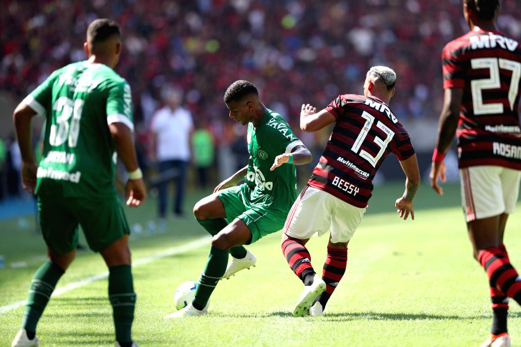 RIO DE JANEIRO, May 13, 2019 - Miguel Trauco (2nd R) of Flamengo vies with Arthur Gomes (2nd L) of Chapecoense during their 2019 Brazilian Serie A 4th round match at the Maracana stadium in Rio de ...