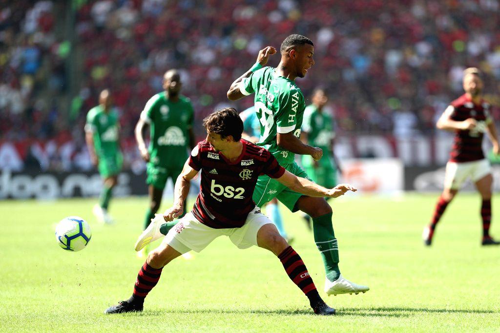 RIO DE JANEIRO, May 13, 2019 - Rodrigo Caio (L) of Flamengo blocks Arthur Gomes of Chapecoense during their 2019 Brazilian Serie A 4th round match at the Maracana stadium in Rio de Janeiro, Brazil, ...