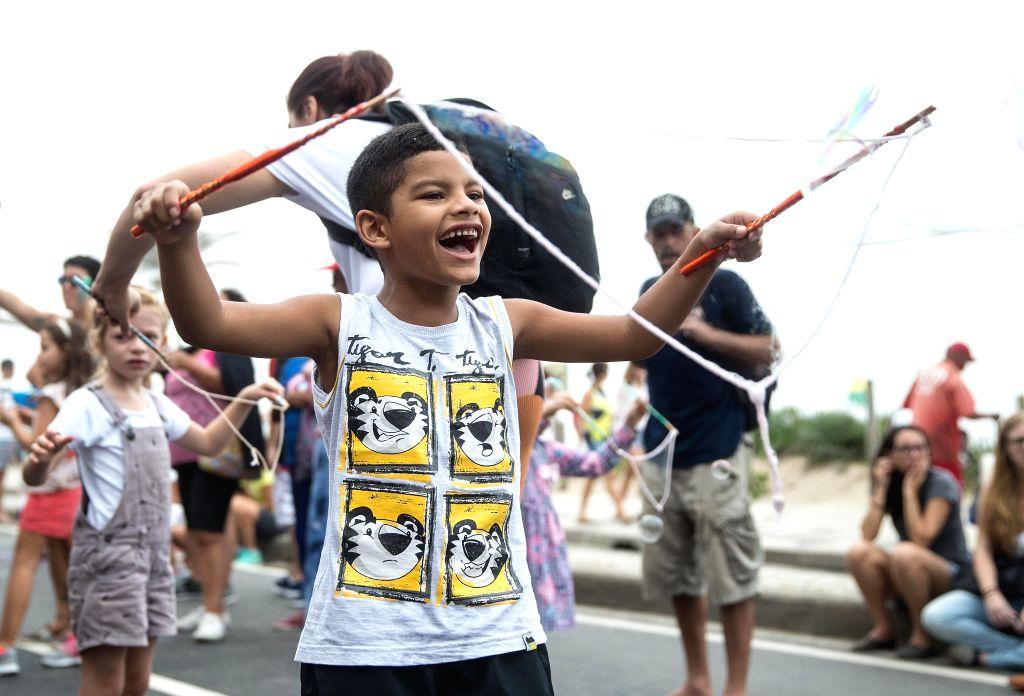 RIO DE JANEIRO, May 28, 2017 - A boy reacts as he makes soap bubbles during the 2017 Global Bubble Parade event at Ipanema Beach in Rio de Janeiro, Brazil, on May 28, 2017. Global Bubble Parade is an ...