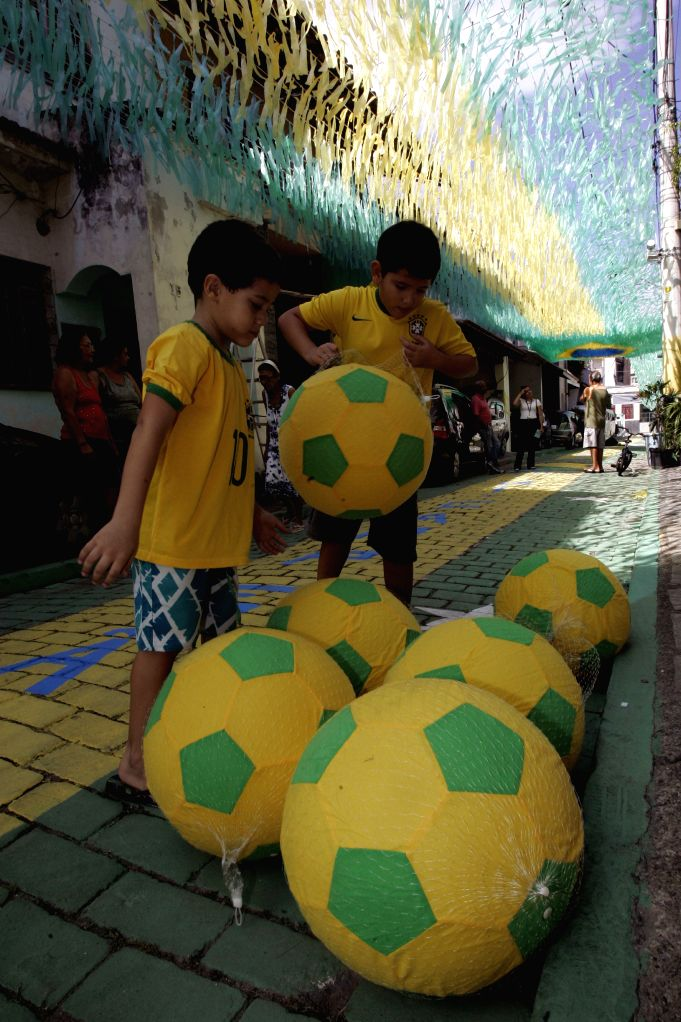 Children play with balls in the Santa Clara in the city of Niteroi in the state of Rio de Janeiro, Brazil, on May 4, 2014. The residents start to decorate the .