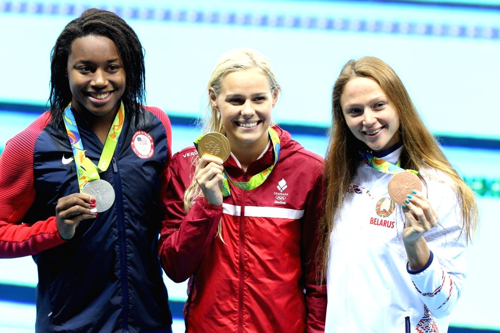Rio De Janeiro: Pernille Blume (Denmark), Simone Manuel (US) and Aliaksandra Herasimenia (Belarus) who won gold, silver and bronze in Men's 50m Freestyle at Rio 2016 Olympics during the presentation ...