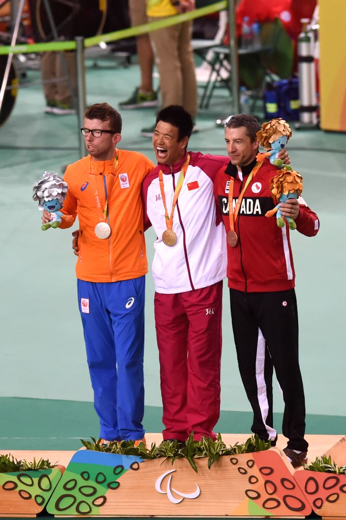 RIO DE JANEIRO, Sept. 11, 2016 - Arnoud Nijhuis of the Netherlands, Li Zhangyu of China and Tristen Chernove of Canada (from L to R) pose on the podium during the award ceremony after the Men's ...