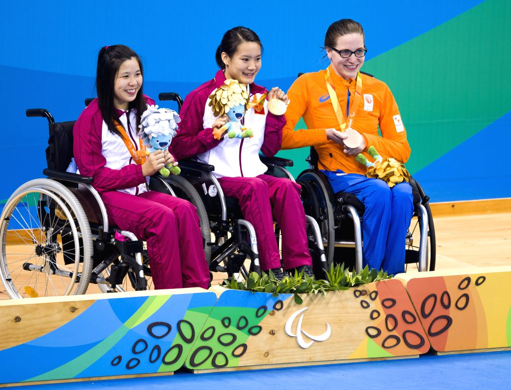RIO DE JANEIRO, Sept. 11, 2016 - Gold medalist Peng Qiuping (C) of China, silver medalist Meng Guofen (L) of China and bronze medalist Lisette Teunissen of the Netherlands pose on the podium after ...