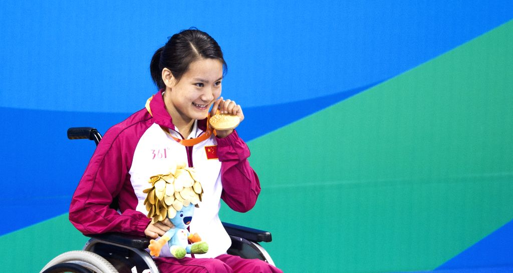 RIO DE JANEIRO, Sept. 11, 2016 - Peng Qiuping of China shows her medal after the women's 50m backstroke S3 at the Rio 2016 Paralympic Games in Rio de Janeiro, Brazil, Sept. 10, 2016. Peng claimed the ...