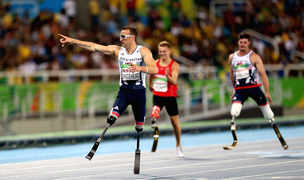 RIO DE JANEIRO, Sept. 11, 2016 - Richard Whitehead (L) of Britain celebrates after winning the men's 200m T42 final of athletics event at the 2016 Rio Paralympic Games in Rio de Janeiro, Brazil, ...