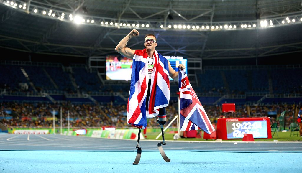 RIO DE JANEIRO, Sept. 11, 2016 - Richard Whitehead of Britain celebrates after winning the men's 200m T42 final of athletics event at the 2016 Rio Paralympic Games in Rio de Janeiro, Brazil, Sept. ...