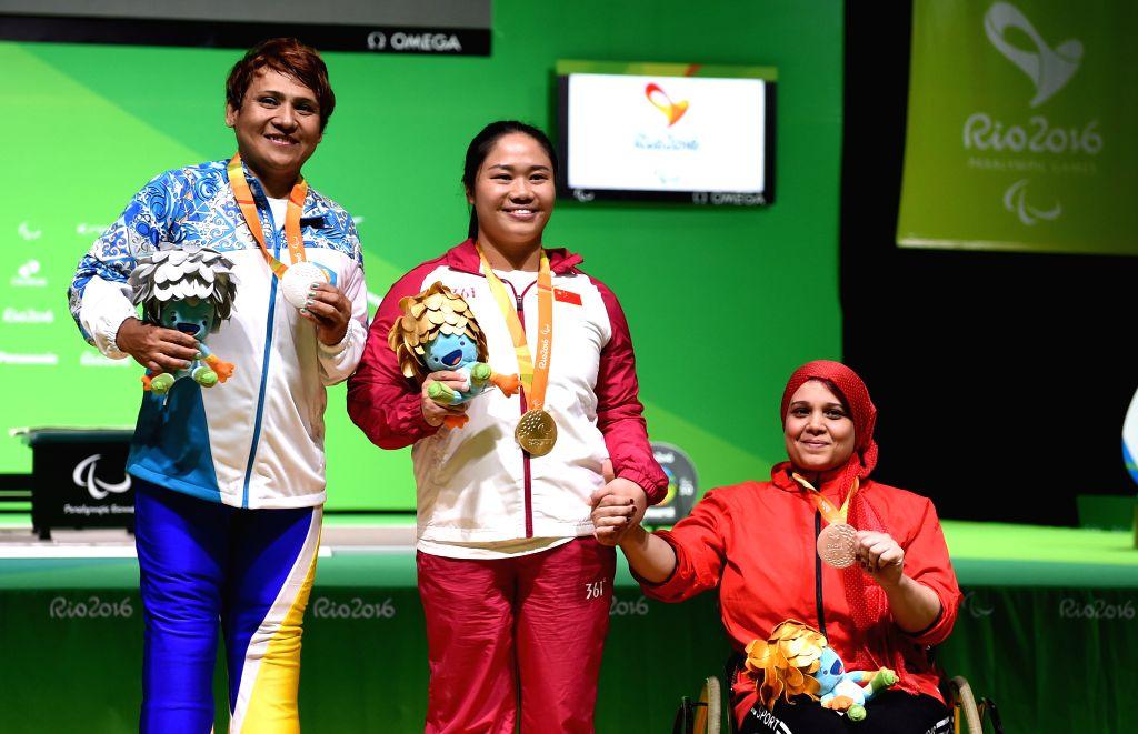 RIO DE JANEIRO, Sept. 12, 2016 - Gold medalist Tan Yujiao (C) of China, silver medalist Raushan Koishibayeva (L) of Kazakhstan and bronze medalist Amal Mahmoud of Eygpt pose on the podium during the ...