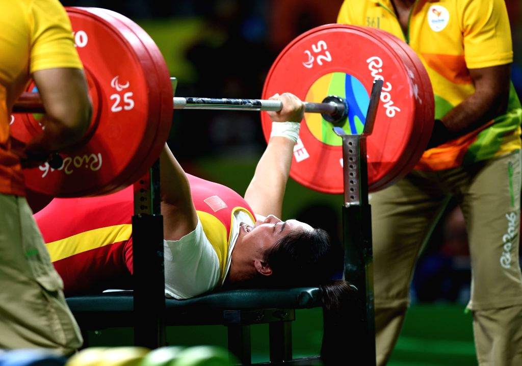 RIO DE JANEIRO, Sept. 12, 2016 - Tan Yujiao of China competes during the women's powerlifting 67kg at the 2016 Rio Paralympic Games in Rio de Janeiro, Brazil, Sept. 11, 2016. Tan claimed the title ...
