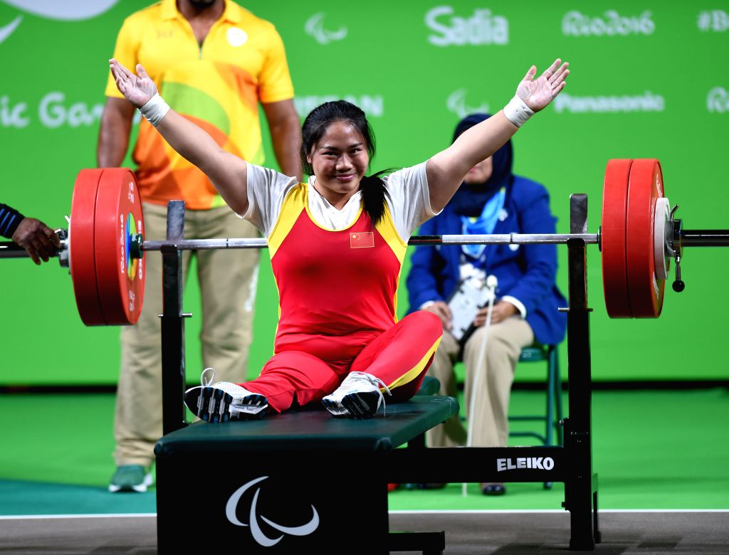 RIO DE JANEIRO, Sept. 12, 2016 - Tan Yujiao of China celebrates during the women's powerlifting 67kg at the 2016 Rio Paralympic Games in Rio de Janeiro, Brazil, Sept. 11, 2016. Tan claimed the title ...
