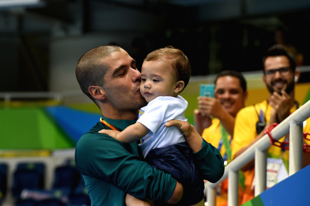 RIO DE JANEIRO, Sept. 13, 2016 - Daniel Dias  kisses his son after the men's 50m freestyle S5 final of swimming event at the 2016 Rio Paralympic Games in Rio de Janeiro, Brazil, Sept. 12, 2016.