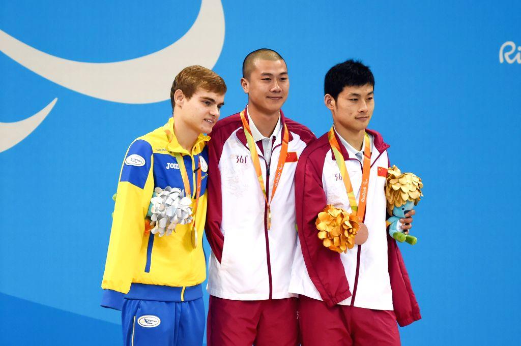 RIO DE JANEIRO, Sept. 13, 2016 - Gold medalist Pan Shiyun (C) of China, silver medalist Levgenii Bogodaiko of Ukrain and bronze medalist Wang Jingang of China pose on the podium during the awarding ...