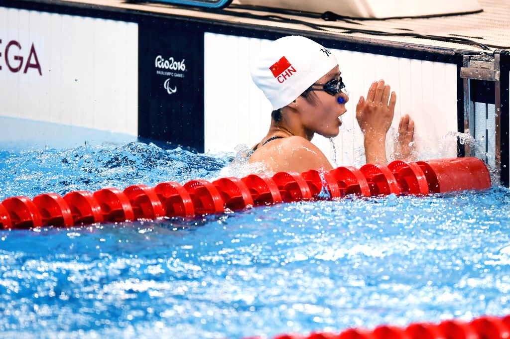 RIO DE JANEIRO, Sept. 13, 2016 - Li Guizhi of China reacts after the women's 50m freestyle S11 final of swimming event at the 2016 Rio Paralympic Games in Rio de Janeiro, Brazil, Sept. 12, 2016. Li ...