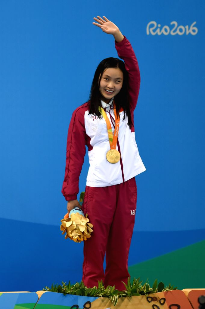 RIO DE JANEIRO, Sept. 13, 2016 - Li Guizhi of China celebrates on the podium during the awarding ceremony for the women's 50m freestyle S11 of swimming event at the 2016 Rio Paralympic Games in Rio ...
