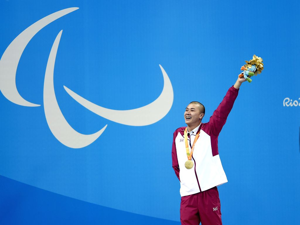 RIO DE JANEIRO, Sept. 13, 2016 - Pan Shiyun of China celebrates during the awarding ceremony after the men's 50m butterfly S7 final of swimming event at the 2016 Rio Paralympic Games in Rio de ...
