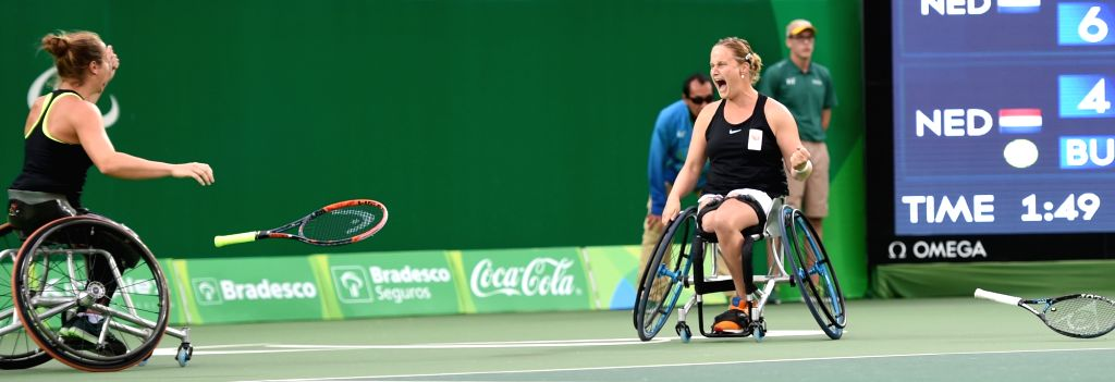 RIO DE JANEIRO, Sept. 17, 2016 - Netherlands' Jiske Griffioen and Aniek van Koot (R) celebrate after defeating their compatriots Marjolein Buis and Diede de Groot during the women's doubles gold ...