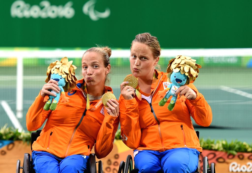 RIO DE JANEIRO, Sept. 17, 2016 - Netherlands' Jiske Griffioen and Aniek van Koot (R) celebrate on the podium after the women's doubles gold medal match of wheelchair tennis event at the 2016 Rio ...