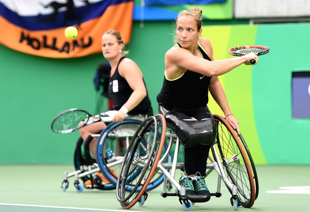 RIO DE JANEIRO, Sept. 17, 2016 - Netherlands' Jiske Griffioen (Front) and Aniek van Koot compete during the women's doubles gold medal match of wheelchair tennis event at the 2016 Rio Paralympic ...