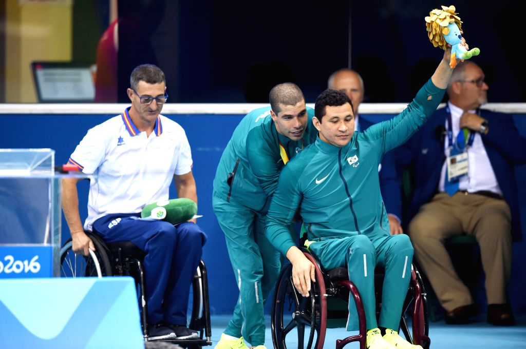 RIO DE JANEIRO, Sept. 18, 2016 - Daniel Dias (C F) of Brazil celebrates with his teammate after Men's 100m Freestyle S5 Final of swimming event at the 2016 Rio Paralympic Games in Rio de Janeiro, ...